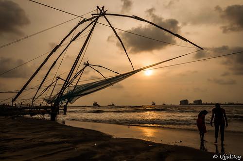 ocean travel sunset sea net beach silhouette evening fishing alone kerala tourist traveller shore lonely kochi chinesefishingnet ujjaldey