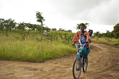 africa people woman baby black smile field smiling bicycle horizontal kids rural children kid clothing community village child adult african centre traditional small transport young mother center southern malawi transportation anthony afrika cloths amused mid based childcare cbcc asael mzimba tonthowere