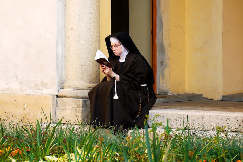 Nun with book