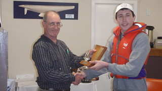 Andrew Coffin receiving the Winter Series Trophy for 1st Junior | by PLSC (Panmure Lagoon Sailing Club)