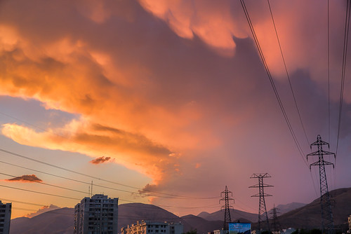 sunset sky people urban orange cloud nature clouds contrast persian scenery couple energy skies iran middleeast places land powerline iranian tehran electricalwire urbanlandscape middleeastern electricalequipment naturalresources energydistribution