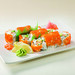Smoked salmon or imitation crabmeat, sliced cucumber, cream cheese.   The Deluxe Philadelphia Rolls are topped with masago roe.