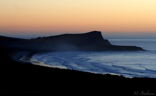 ocean morning sea newzealand beach silhouette sunrise dark dawn bay coast otago otagopeninsula canon400ddslrcanonef70200mmf28lusm