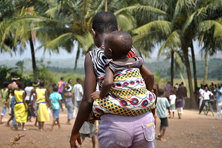 Ghana mother and child visit water pump provided by USAID. | by USAID Africa