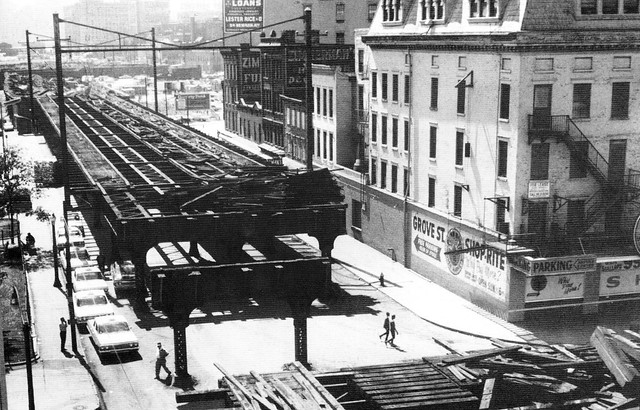 Demolition of the old Pennsylvania Railroad elevated tracks leading to their terminal at Exchange Place. Photo taken from Grove Street looking east to Exchange Place and the Colgate Plant. Jersey City. 1965