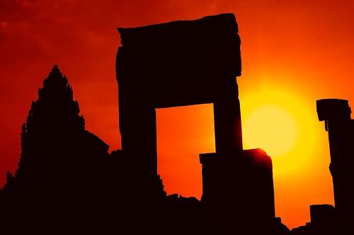 door sunset sun silhouette asian nikon ruins asia cambodia khmer silhouettes angkorwat doorway empire redsky southeast siemreap setting unescoworldheritage kampuchea 9thcentury lolei roluosgroup bakongtemple d700 2470mmf28g nathanhortonphotographytour