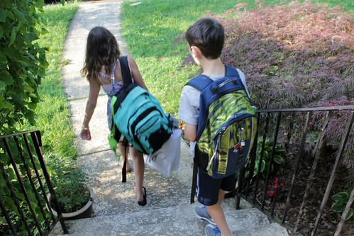 the kids, with their heavy backpacks, head out to the bus | by woodleywonderworks