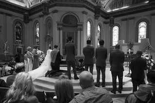 Wedding Couple Kneel Before Altar | by staticantics