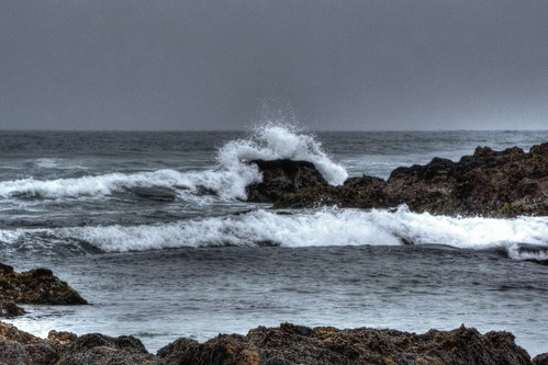 waveoverrocks rocks breakingwaves waves beach water waterpictorial ocean pacificocean pacificgrove montereybay montereypeninsula california asilomarstatebeach joelach