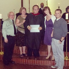 My family and I at graduation. Just after I received my hood. Just before I got my broomstick.