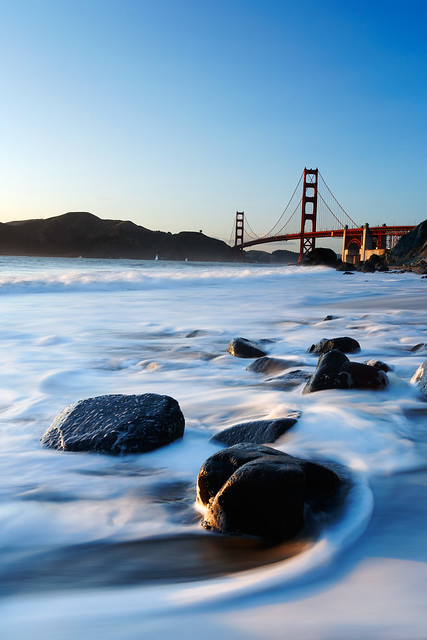 LC512 - Golden Gate Bridge and surf on Marshall Beach rocks, Golden Gate National Recreation Area, San Francisco, California, USA