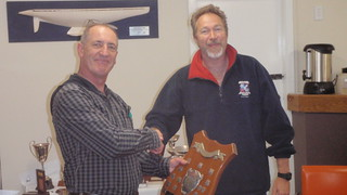 Don Harland receiving 1st Senior Handicap Series Webster Shield from Will Perry Commodore | by PLSC (Panmure Lagoon Sailing Club)