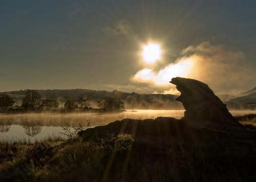autumn mist rock sunrise real rising bravo dam central alexandra nz otago beams sillhouette butchers