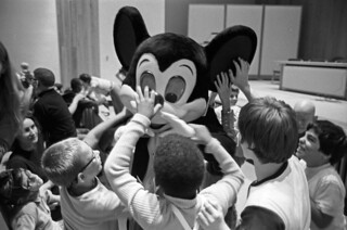Blind children meet Mickey Mouse by touch at Perkins School for the Blind, Watertown | by Boston Public Library