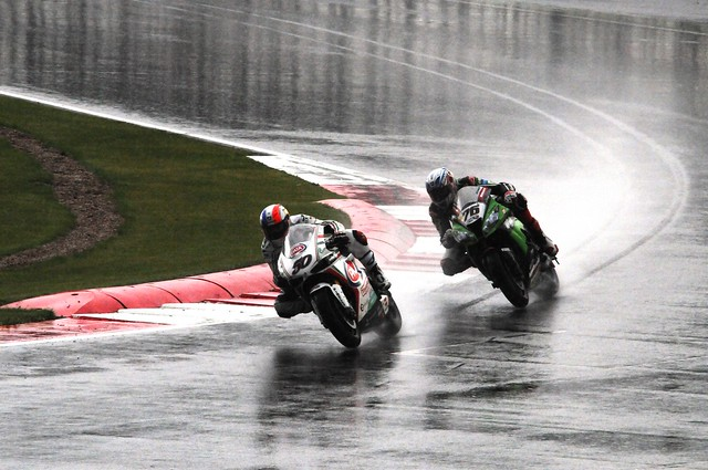 exiting Club corner in the wet, S Guintoli & L Baz