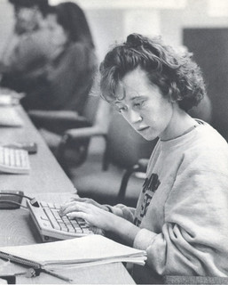 Kelly Redfield '92 working at a computer on her term paper in 1992