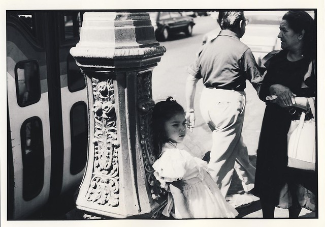 Young Latina girl at bus stop in Los Angeles 1987