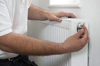 Radiator Key Being Used | by CORGI HomePlan
