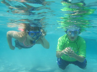 Amanda and Dylan swim by
