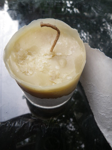 ripping away beewax candle mold | by Shawn Caza
