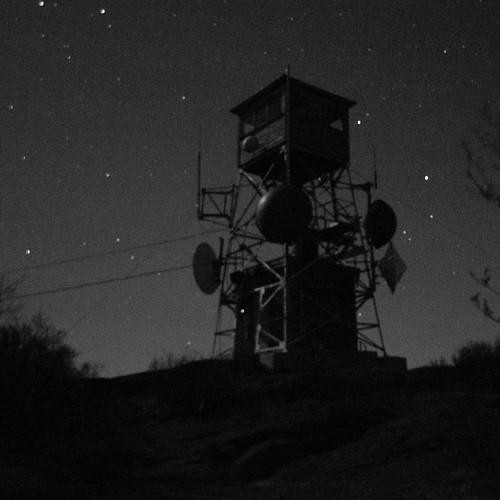 light shadow sky moon mountain tower night dark stars fire cabin long exposure newhampshire nh monotone dim pitcher communications telecom stoddard