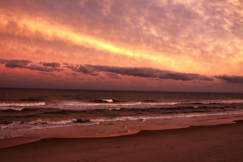 canoneos50d 28135mm sunset sky ocean water waves cloud clouds wave sun settingevening northcarolina atlanticocean atlantic nc topailbeach pronouncedtopsl fakehdr