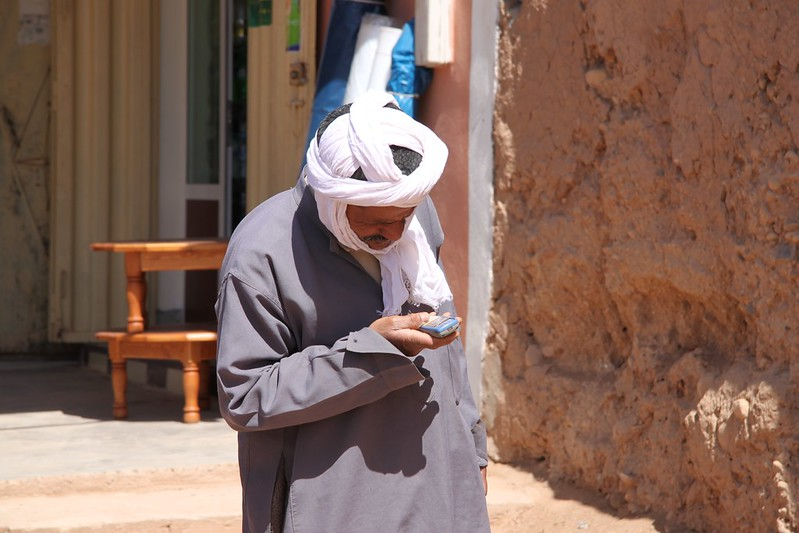 A mixing of cultures! An elderly gentleman and his mobile phone, nr the Algerian border, Morocco