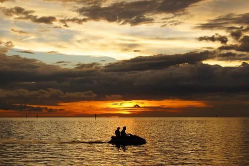 sunset woman man gulfofmexico water clouds florida jetski