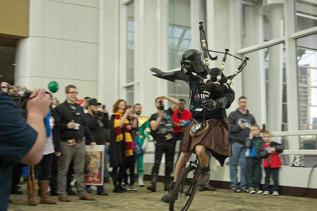 Darth Vader in a Kilt playing the Bagpipes on a Unicycle