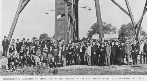 gold goldmining miners mining mines statelibraryofqueensland slq queensland largegroupphoto 1900s commencementphoto suits hats fashion beards moustaches walkingstick windingplant hut mininginfrastructure men lights scottish dirt grass