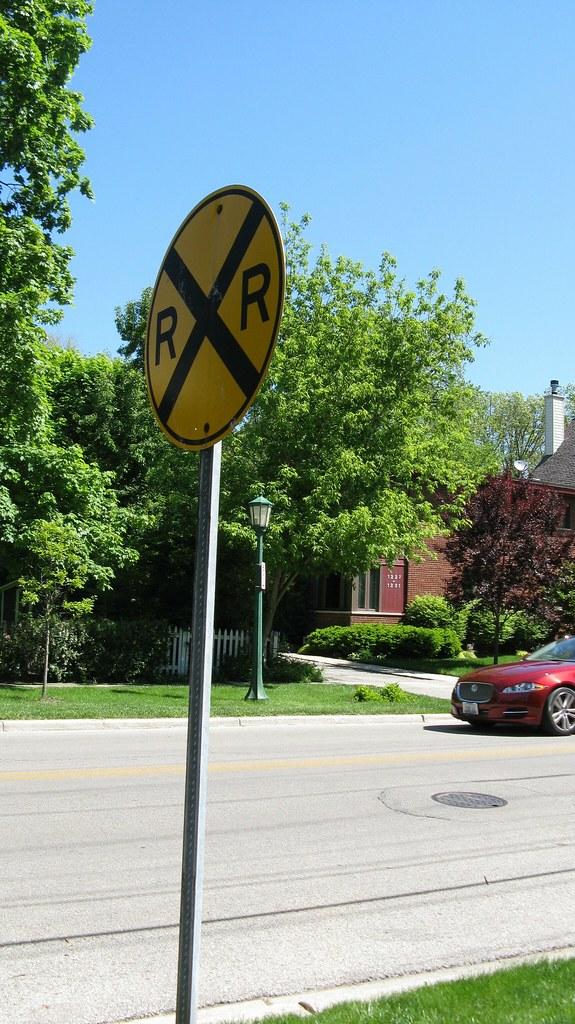 Standard railroad crossing ahead sign on Isabella Street