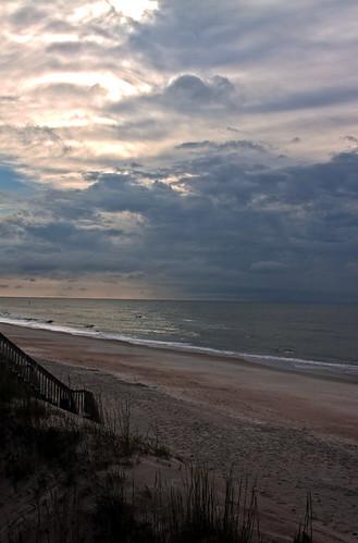 ocean sunset sky cloud sun water clouds nc waves wave northcarolina atlantic atlanticocean 28135mm hss canoneos50d pronouncedtopsl settingevening topailbeach