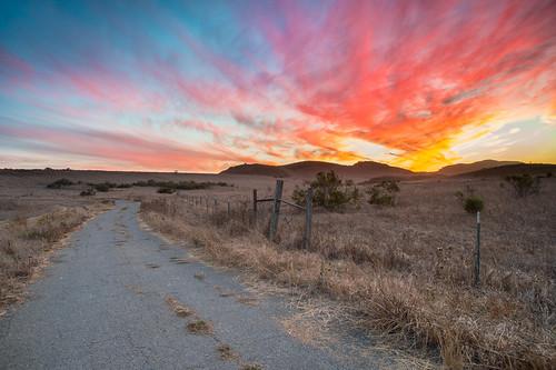 road sunset abandoned field sunrise fence openspace conejovalley santamonicamountainsnationalrecreationarea singhrayrgnd ranchosatiwawa darrylbensonreversegraduatedneutraldensityfilter