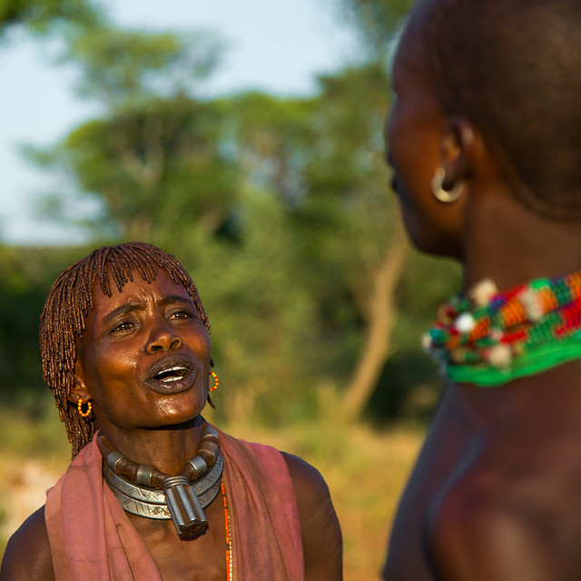 Hamer tribe woman waiting to be whipped during a bull jumping ceremony, Omo valley, Turmi, Ethiopia