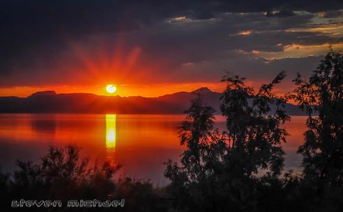 blue sunset red sky orange sun lake color set sunrise island utah great salt antelope interstate rise 80