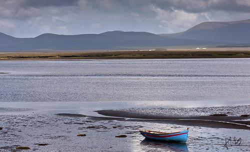 ireland rowboat mayo redandblue dappledsunlight westofireland beautifulireland nephinbeg tullaghanbay