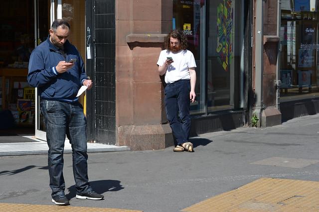 Dual Texting, Stevenson Square, Northern Quarter, Manchester, England.