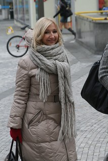 Smiling blonde covered in the big scarf