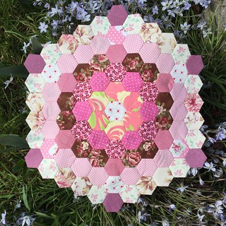 Mega #hexagon of 1 inch #hexies that keeps growing. I'm thinking of making a diamond or a star of it now