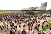 """Friends and family gather in the UH West Oahu upper courtyard and great lawn following the fall 2016 commencement exercise at UH West Oahu on December 10, 2016.   View more photos at: <a href=""""https://www.flickr.com/photos/uhwestoahu/albums/72157673795123933"""">www.flickr.com/photos/uhwestoahu/albums/72157673795123933</a>"""