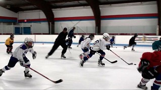 Brad Perry skating with students at a hockey school in Chicago | by Brad Perry