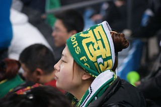 Focus on the game - Beijing Guoan supporter girl | by Ju1ian