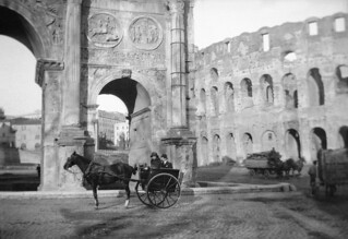 Horse carriages and monuments in Rome, Italy