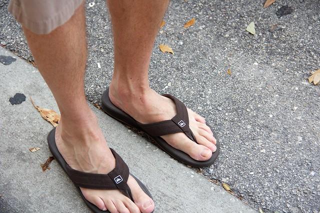 long toes in flip-flops.