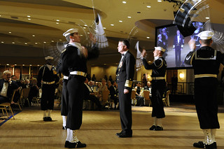 A ceremonial rifle drill team performs at the Navy-Marine Corps Relief Society Ball. | by Official U.S. Navy Imagery