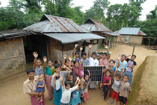 Bangladeshi village celebrating as they display their first solar panel | by ILO in Asia and the Pacific