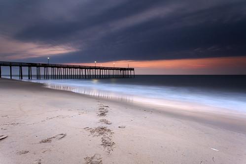 longexposure morning light reflection beach clouds sunrise dawn pier sand day glow cloudy footprints maryland oceancity filters atlanticocean waterscape neutraldensity canon5dmkii singhrayrgnd ef1740f40lusm