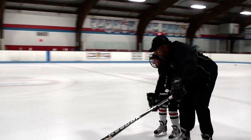Brad Perry showing proper hand position to a mite hockey player at a hockey camp | by Brad Perry