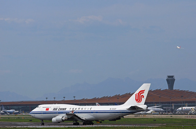 Air China Boeing 747-4J6 B-2447 Cleared for Take off while a JAL Boeing 737 NG Climbing at PEK/ZBAA