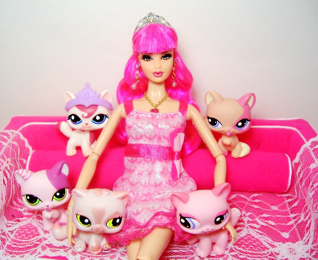 Rosalie shows her collection of LPS pink cats